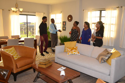 CEO, Mr. Sawh taking Mr. & Mrs. Hinds on a tour of the house