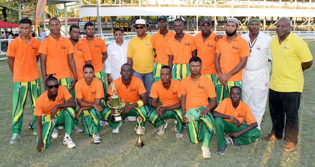 The victorious Rose Hall Town Gizmos and Gadgets team, strike a pose with the trophy, after defeating Albion in the final. Fifth from left is General Manager of Bakewell, Rajin Ganga, while on his left is Managing Director of NAMILCO, Bert Sukhai.
