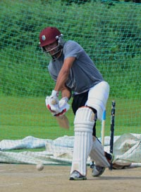 Former Guyana and West Indies skipper Ramnaresh Sarwan was caught by Chronicle Sport photographer Adrian Narine playing a forward defensive shot during his net session at the Everest Cricket Club ground yesterday.