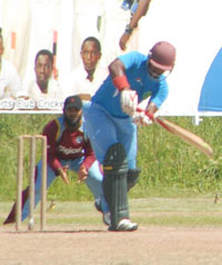 Guyana and West Indies 'A' team middle order batsman Assad Fudadin is at slip admiring Robin Bacchus playing to the onside, during last Friday's practice match at the Everest Cricket Club ground. (Photo by Sonell Nelson)