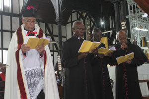 NEWLY INSTALLED: Standing from left are: The Very Reverend Paul Andrew Carto; The Venerable Terry Nathaniel Davis; The Reverend Clifton Ashton Elias; and The Reverend Jerrick Fitzgerald Rayside
