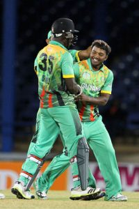 Veerasammy Permaul is congratulated by teammates for spinning out the tail in the NAGICO Super50 match on Tuesday night.