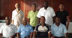 Members of the > GCUC executive standing from right are Heuvel Cunha, Dawchand Nagassar, M. Yosef-Yisrael  and Zaheer Mohamed.  Sitting from right are Shannon Crawford, Dhieranidranauth Somwaru, Eddie  Nicholls and Areligh Rutheford. Missing are Zabeer Zakier  and Nigel Duguid