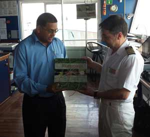 Mr. Indranauth Haralsingh presents a book, 'Rupununi' to Captain Alex Dudov