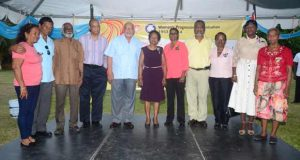 From left Sandra Baldeo, Harripersaud Nokta, Navin Chandarpaul, Clement Rohee, President Donald Ramotar, Indra Chandarpaul, Sheila Verasammy, Prime Minister Samuel Hinds, Patrica Benn, Gloria Beharry and Carmen Seeran.