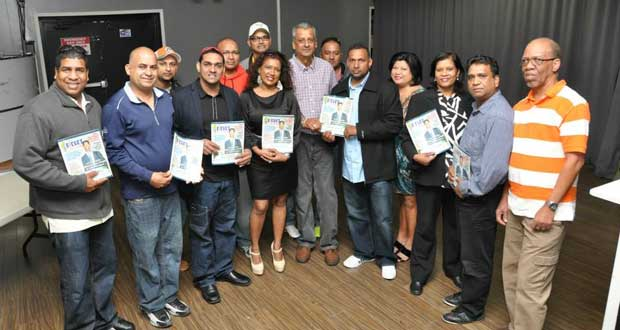 ATTENDEES at Saturday's launching pose with copies of the magazine. (Picture courtesy Bobby Ramlagan)