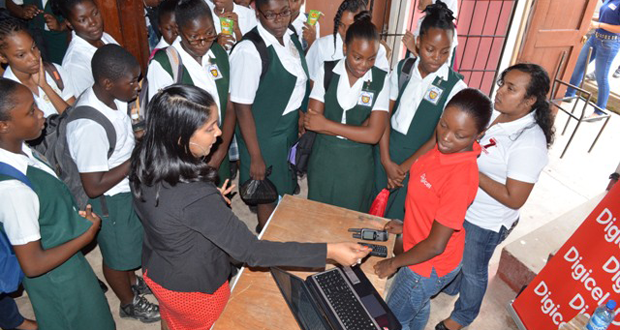 Students visiting the Digicel booth at the event