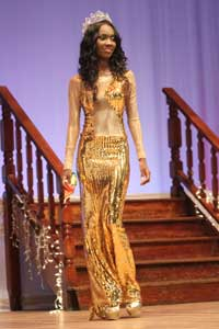 Outgoing Queen Raquayyah Boyer takes her final walk before handing over the crown to her successor, Rafieya Husain.