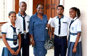 North Georgetown Secondary's Headmistress and students at the National Assembly yesterday (Photos courtesy of the Ministry of Education)