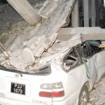 Car crashes into unfinished building bringing it down