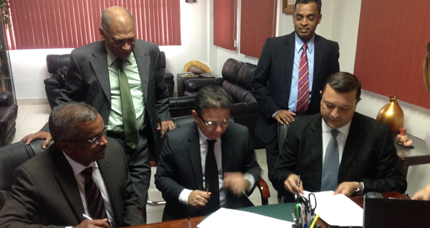 Seated from left: GRDB General Manager, Mr. Jagnarine Singh, Director General of Panama's Institute of Agriculture Marketing, Mr. Edwin Cardenad signing the rice sales contract. Standing, from left, are Agriculture Minister, Dr. Leslie Ramsammy and RPA General-Secretary, Dharamkumar Seeraj