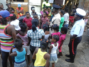 Deputy Commander Moore addressing the children and community members prior to handing over the items