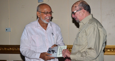 President Donald Ramotar is happy to receive a copy of Mr. Insanally's 'Dancing Between the Raindrops.'