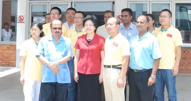Madam Lin Bin Centre In Front Of The Gphc With Members 11th Chinese Medical Brigade To Guyana Yellow Jerseys Minister Health Dr Bheri