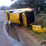 Taxi driver escapes death as car topples at Sparendaam