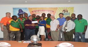 President of the GRFU is all smiles while he collects the US$10 000 cheque from Beharry Group of Companies Marketing Director Anjuli Beharry-Strand while other executives and players look on.