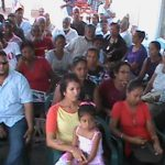 Residents of Huis't Diren listen attentivly to President Ramotar at a community meeting