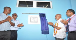 President Donald Ramotar, second from right, unveils a plaque declaring the warm-up pool open. Looking on are (from left) MCYS Permanent Secretary, Alfred King, Director of Sport Neil Kumar and Minister of Culture, Youth and Sport Dr Frank Anthony (Photo by Delano Williams)