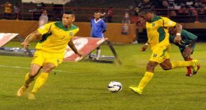 Matthew Briggs (left) and Neil Danns during their International debut for Guyana against Grenada at the Guyana National Stadium. (Delano Williams photo)
