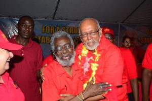 Comrades-of-old, Dr Roger Luncheon and President Donald Ramotar having a good time at yesterday's rally at Stewartville, West Coast Demerara