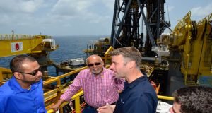 President Donald Ramotar and Minister of Natural Resources and the Environment, Robert Persaud listen keenly to an official on board the ExxonMobil's Deepwater Champion oil rig yesterday