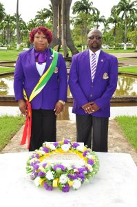 APGI President, Mr Errol Lewis, and its Organising Manager, Ms Bonita Montaque paying tribute to Guyana's first president (Photos by Delano Williams)
