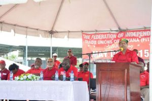 GAWU's Head, Komal Chand at the podium, with Minister Clement Rohee, PPP/C's Prime Ministerial Candidate Elisabeth Harper, Prime Minister Samuel Hinds, President Donald Ramotar and FITUG Head , Carvil Duncan at the head table at the May Day 2015 rally at the National Park