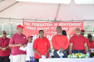 Singing 'Solidarity Forever' at the May Day Rally. From left Minister Clement Rohee, PPP/C's Prime Ministerial Candidate Elisabeth Harper, Prime Minister Samuel Hinds and President Donald Ramotar