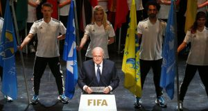 FIFA President Sepp Blatter addresses the audience at the opening ceremony of the 65th FIFA Congress in Zurich yesterday. The leader of soccer's governing body has rejected calls to resign. (Arnd Wiegmann/Reuters)