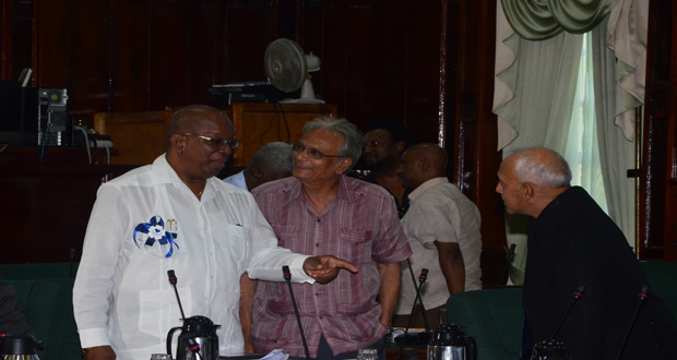 Finance Minister, Mr Winston Jordan [left) in amiable conversation with Education Minister, Dr Rupert Roopnaraine (centre), and Communities Minister, Mr Ronald Bulkan (Photo by Adrian Narine)