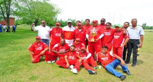 The winning Cricketers Cove team pose after their victory over Dant. OSCL president Albert Ramcharran is at extreme right.