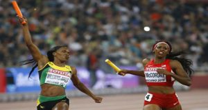 Novlene Williams-Mills of Jamaica (L) crosses the finish line beside Francena McCorory of the U.S. in the women's 4x400 metres relay final at the 15th IAAF Championships at the National Stadium in Beijing, China. (Reuters/Damir Sagolj)