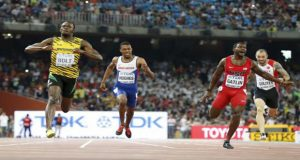 Usain Bolt of Jamaica (L) crosses the finish line ahead of Justin Gatlin (2nd R) from the U.S., Zharnel Hughes of Britain (2nd L) and Ramil Guliyev of Turkey in the men's 200m final during the 15th IAAF World Championships at the National Stadium in Beijing, China, yesterday. (Reuters/Lucy Nicholson)