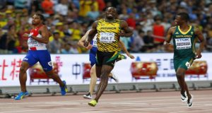 Usain Bolt of Jamaica (C) runs past Roberto Skyers of Cuba and Anaso Jobodwana of South Africa (R) to win their men's 200 metres semifinal.