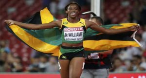 Jamaica's Danielle Williams wins the world championship 100 metres hurdles gold as her more experienced rivals crumble under pressure, yesterday.