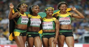 Elaine Thompson, Veronica Campbell-Brown, Shelly-Ann Fraser Pryce and Natasha Morrison of Jamaica react after winning the women's 4x100m relay during the 15th IAAF World Championships at the National Stadium in Beijing, China, yesterday. (Reuters/Lucy Nicholson)