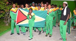 The Guyana boxing contingent display the Golden Arrowhead on the opening night of the tournament. (Delano Williams photo)