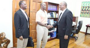 GFF Wayne Forde looks on while 1st VP Brigadier (rtd) Jullian Bruce Lovell greets Minister of State Joseph Harmon. (Photo courtesy of the Ministry of the Presidency)