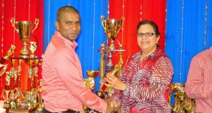 Dant's Hemnarine Chattergoon collects his Grand Champion MVP award for Consul General Ms. Sattie Sawh.
