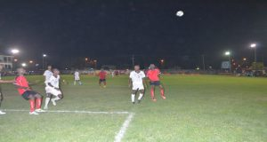 The Riddim Squad defenders mark closely their semi-final opponents Santos FC.