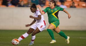 Deanne Rose, who scored twice in her team's win over Guyana, being defended by Kayla De Souza.