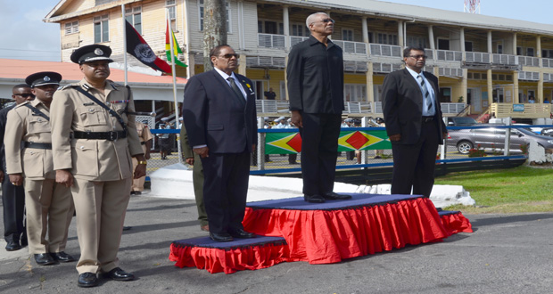 President David Granger taking the salute at the opening of the Annual Police Officers' Conference yesterday. next to him are Prime Minister Moses Nagamootoo, Minister of Public Security Khemraj Ramjattan and Police Commissioner Seelall Persaud