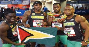 The Guyana men's team at the Armory Invitational show off their flag, from left, Winston George, Earl Lucas, Chavez Ageday and jeremy Bascom