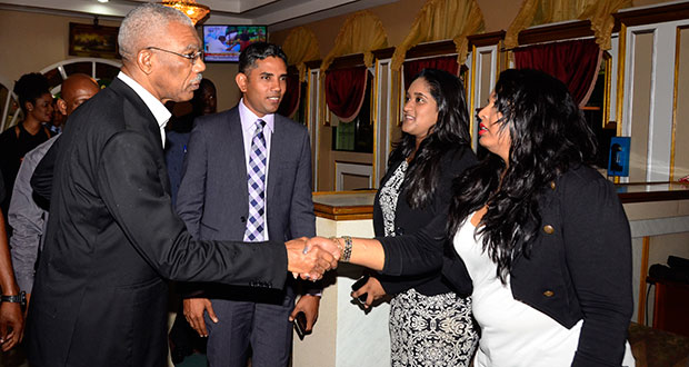 President David Granger greeting members of the executive of the Guyana Press Association: [from right) Fareeza Haniff, Nazima Raghubir; and President of the Association, Neil Marks