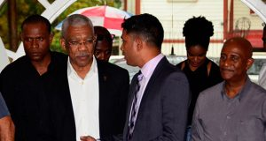 President of the Guyana Press Association (GPA) Neil Marks engages President David Granger on his arrival to address a training workshop for journalists last Friday. (Adrian Narine photo)
