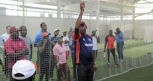 Former West Indies fast bowler, Tony Gray, demonstrates during yesterday's session. (WICB Media/Randy Brooks)