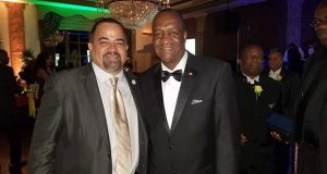 Minister of State, Joseph Harmon, with a guest at 'Signature Grand', Fort Lauderdale, Florida