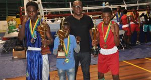 GBA's president Steve Ninvalle (second right) strikes a pose with the best boxers of the three categories contested in the Tri-Nations Schoolboys and Juniors boxing championships.From left: St. Lucia's Nathan Ferirre, Omar Pollard for Juniors and Shaquiel for Schoolboys.