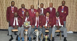 WIFBSC Short Range champs 2016, Guyana, display trophies and medals after winning the WIFB Short Range and Wadadli Cups as well as other Individual trophies and medals. Seated from right are Paul Slowe, Dylan Fields, Mahendra Persaud, Lennox Braithwaite and Ransford Goodluck. Standing from left are Peter Persaud, John Fraser, Terrance Stuart, Sherwin Felicien, Leo Romalho and Ryan Sampson.