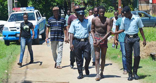 Orin Jules being taken away by police [Ivan Bentham photo)